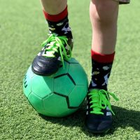 Kids foot on soccer ball